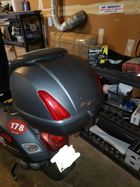 Vespa topcase with lid reattached and lockable.