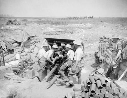 Battle of Pozieres Ridge 23 July - 3 September: An 18 pounder gun, its crew stripped to the waist in the sunshine, putting over curtain fire from the Carnoy Valley near Montauban. Battle of Pozieres Ridge. 18 pdr. Putting over curtain fire or barrage. Carnoy Valley, near Montauban. 30 July 1916.Q 4066