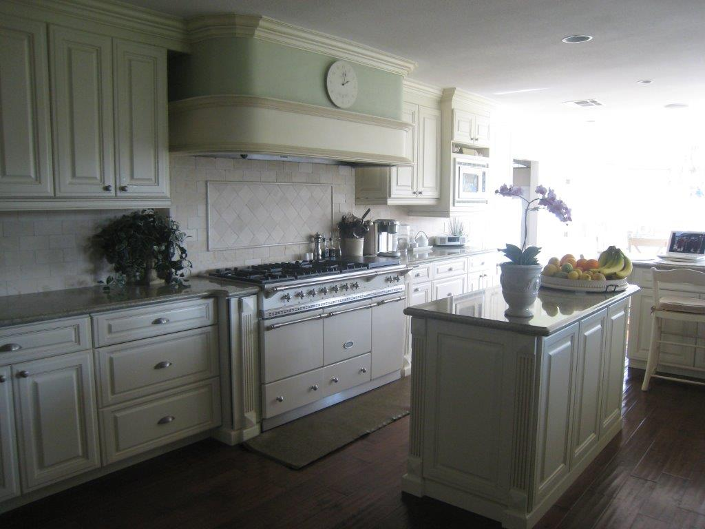 kitchen cabinets santa ana ca round sink white cabinetry with fluting and raised panel