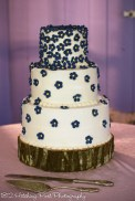 Sweet navy flowers with yellow centers on wedding cake