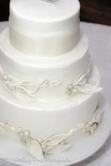 Leaves and berries on cream wedding cake