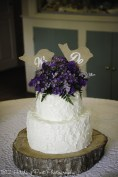 """Rough iced cake with """"We Do"""" topper"""