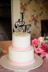 Smooth cake with pink ribbon