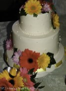 Bright flowers on dotted wedding cake