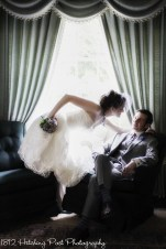Couple in window of music room