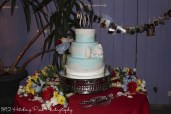 Cake with bouquets and phtoos behind