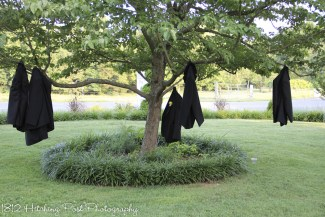Guys hung their jackets in teh trees
