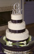 Chocolate ribbon on piped cake