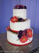 Coral and purple on wedding cake