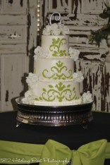 Green fondant applique on wedding cake