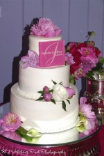 Smooth cake with pink spring flowers