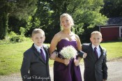 Bridesmaid escorted by jr. groomsmen