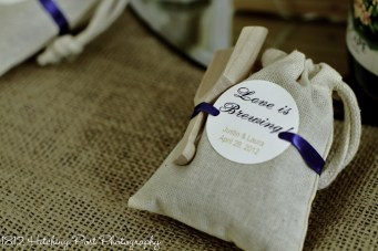 "Party favor of little bags of coffee beans with scoop and ""Love is Brewing"" on the label"