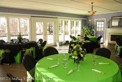 Lime overlays with black chair covers and lime sashes