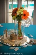 Turquoise with orange gerber daisy centerpiece