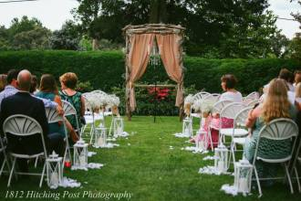 Ceremony centered on boxwoods