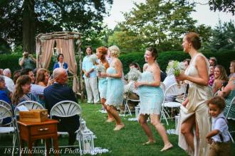 Girls dancing down the aisle