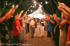 Sparkler send-off near tent