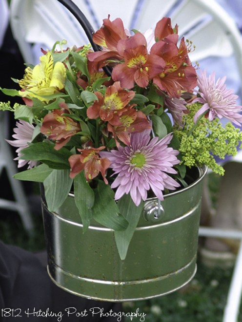 Tin bucket filled with fresh spring flowers