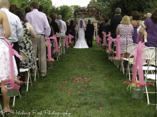 Galvanized buckets filled with lime and hot pink and tied with tulle