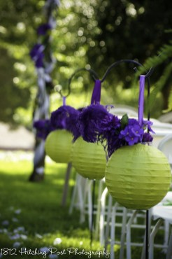 "Lime green Chinese lanterns ""filled"" with purple silk flowers"