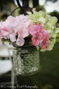 Pink hydrangeas in hobnail glass jars