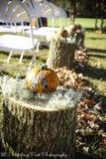 Bride provided pumpkins on top of 1812 Hitching Post wood aisle markers