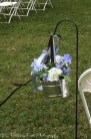 Silk blue and white hydrangeas in galvanized bucket hung with blue and chocolate ribbons