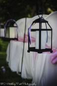 Black lanterns with pink, navy, and white ribbon