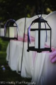 Black lanterns with pink, navy, and white ribbon