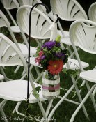 Mason jar wrapped in ribbon with bold flowers