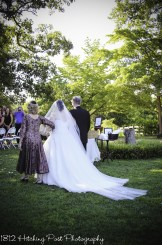 Parents walk bride down aisle