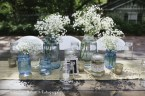 Cluster of blue and clear mason jars