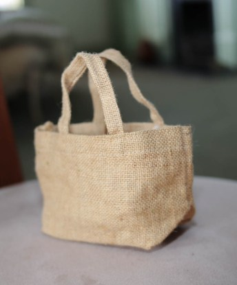 "Tiny burlap ""bag"" for petals or leaves"