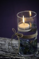Floating candle in twine wrapped vase