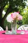 Silk flowers in cylinder vase