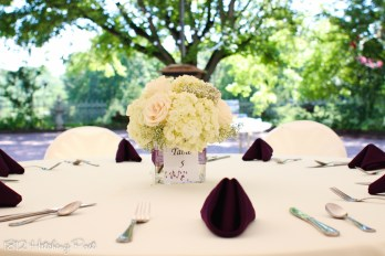 Simple square vase with ribbon and table number