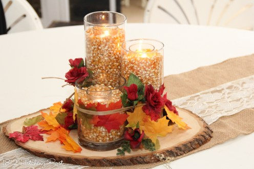 Trio of vases filled with popcorn and candles