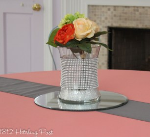 Diamond bling wrap on curved vase with coral floral arrangement