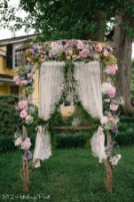 Blush & lilac silk flowers with curtains and chandelier