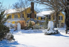 Snow on the lawn at the 1812 Hitching Post