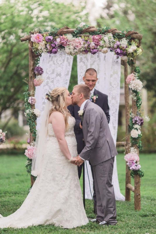 Lace curtains; lilac and blush silk flowers
