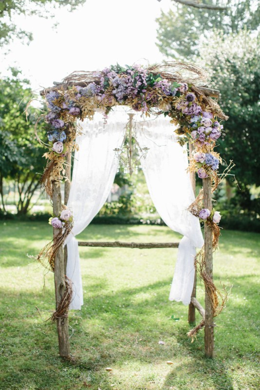 Lilac silk flowers with bride provided gold garland entwined