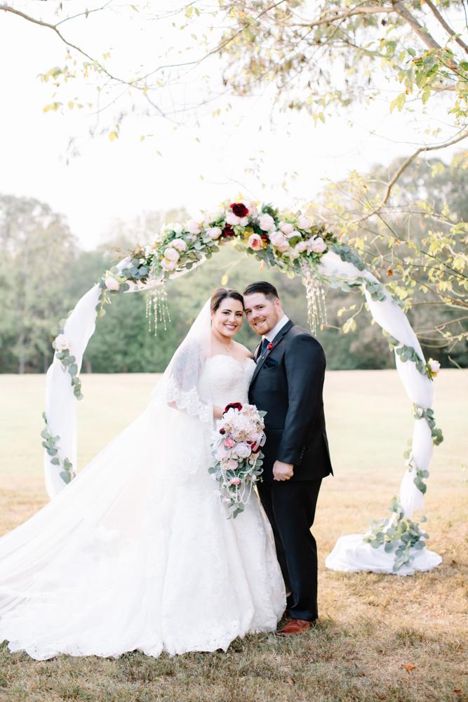 Wedding under circle arbor