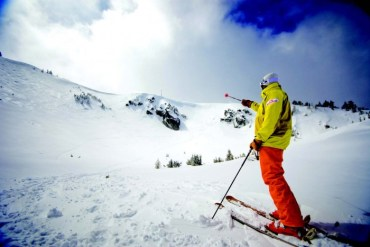 2011-Winter-Oregon-Adventures-Southern-Cascades-Mt-Ashland-skier-pointing-with-pole