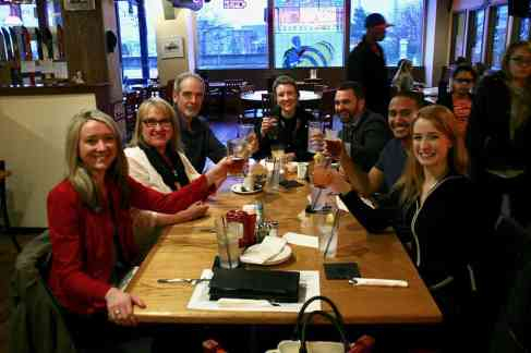 happy patrons toasting at Harmon Brewing Co