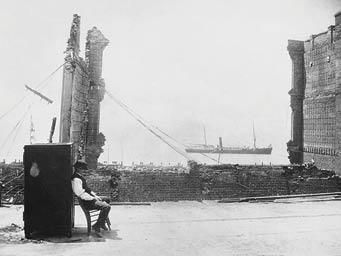 A man guards a safe from looters in the wake of the fire. (photo: MOHAI, Seattle Historical Society Collection, SHS511)