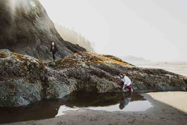 Bridget Ideker of Tacoma and Julia Gervais from Minnesota explore tide pools at Second Beach.