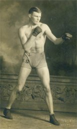Photo of Kid Osborne – On the back of the photo is written: Best Wishes to my Chum Horace Garment, From Kid Osborne Middle Weight Champion of Western Canada. Source: CVWM