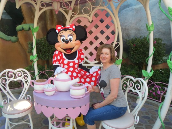 Mom enjoying tea with Minnie at her home!